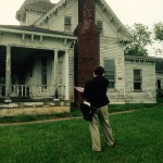 Outside of the J. Sidna Allen home is Hunter Greene, RA ~ Project Manager, Architect